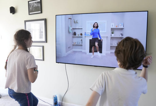 Children take part in an online PE lesson with Joe Wicks