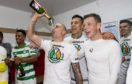 Celtic captain Scott Brown celebrates last season's title win. But for some other players, expensive champagne is the social drink of choice