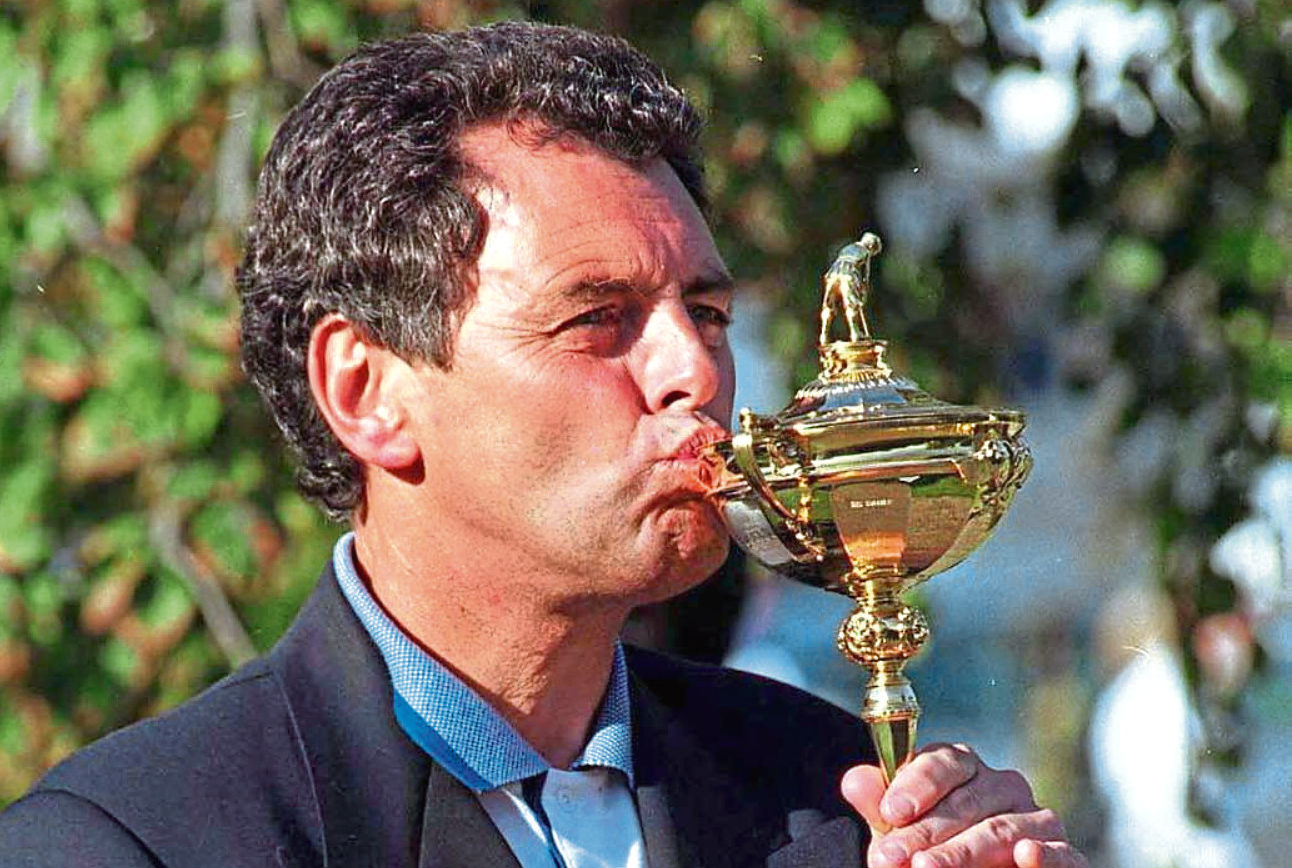 Europe skipper Bernard Gallacher celebrates clinching victory over the USA at Oak Hill in 1995 to get his hands on the trophy