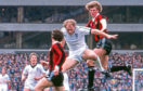 Alan Brazil challenges Manchester City's Tommy Caton in 1981