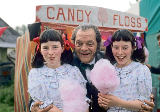 Chrissie (left) and Kitty with David Jason as their on-screen dad Pop Larkin in 1991