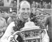 Stirling Moss with the Aintree 200 trophy in 1954