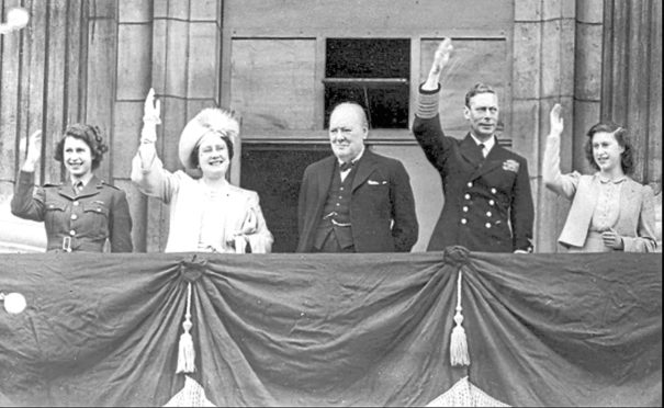 On the balcony at Buckingham Palace overseeing VE Day celebrations are Princess Elizabeth, Queen Elizabeth, Prime Minister Winston Churchill, King George VI and Princess Margaret