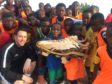 Coach Mark Holmes with pupils at his football academy in Ghana