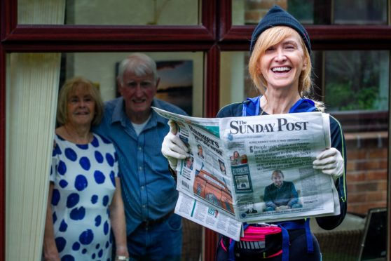 Out for her daily run that has turned into a paper round, broadcaster Jackie Bird drops off a Post with parents,                 Ronnie and Linda, in East Kilbride
