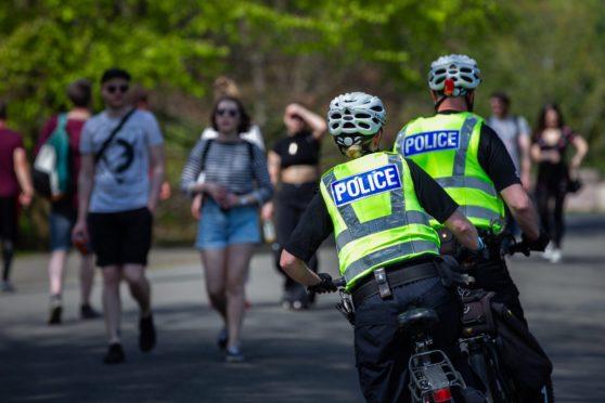 Officers on patrol in Kelvingrove Park yesterday