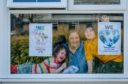 Nurse Pamela Griffin and her children with our poster showing support to the NHS