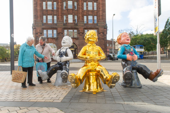 Wullie fans enjoy a sneak preview of some statues in Dundee before they hit the streets of Scotland last summer