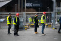Contractors at the SEC in Glasgow as work begins last week to build new NHS Louisa Jordan hospital