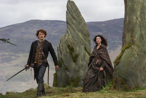 Outlander's Heughan and Balfe at Clava Cairns