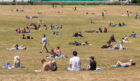 People enjoying the good weather in Greenwich Park, south London, as the public are being reminded to practice social distancing following the relaxation of lockdown restrictions
