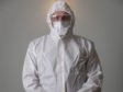 Behind the mask: Funeral director                       Cameron McGillivray in full PPE suit