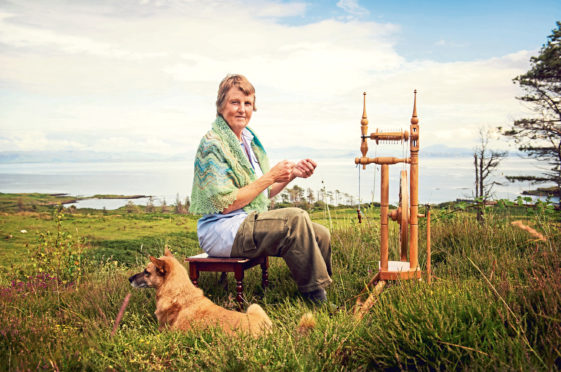 Jenny Robertson embraces Eigg's peace and quiet with spinning wheel and pet dog