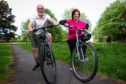 Postman Pat Mutter and charity service manager wife Sandra enjoying                        their weekend cycle around Glasgow