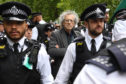 Piers Corbyn is led away by police after a protest against lockdown at Hyde Park, London yesterday