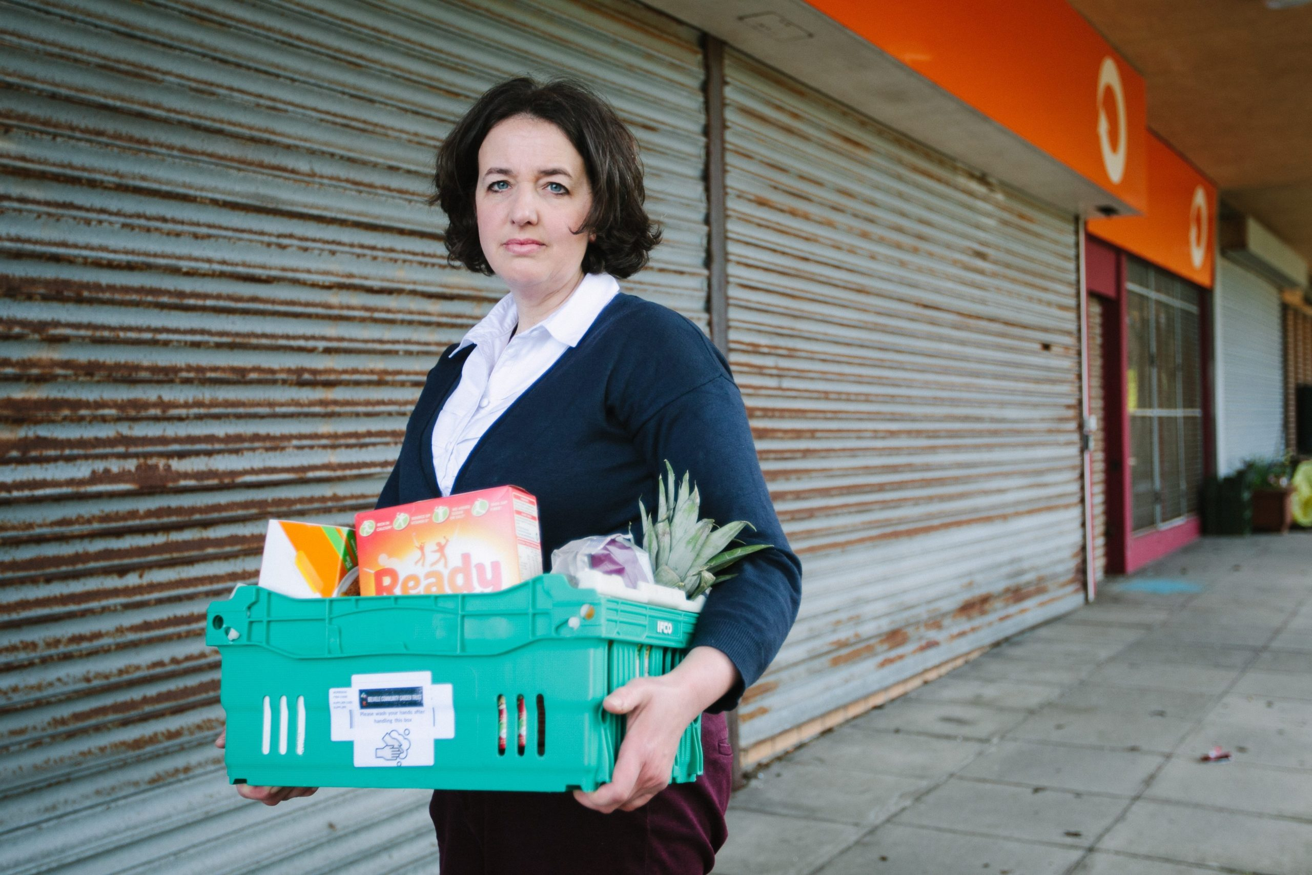 Laura Reilly at Crawfurds Burn Community Centre in Greenock with a food box for the vulnerable