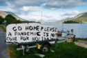 A sign at the side of the road in Lochaber, near Glencoe, this week urges holidaymakers not to visit during the lockdown