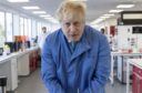 Boris Johnson visits Mologic lab in Bedfordshire to announce £46m funding for testing kits on March 6 before, five days later, suspending the UK programme of testing and contact tracing