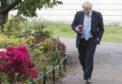 Prime Minister Boris Johnson takes a walk in St James' Park in London
