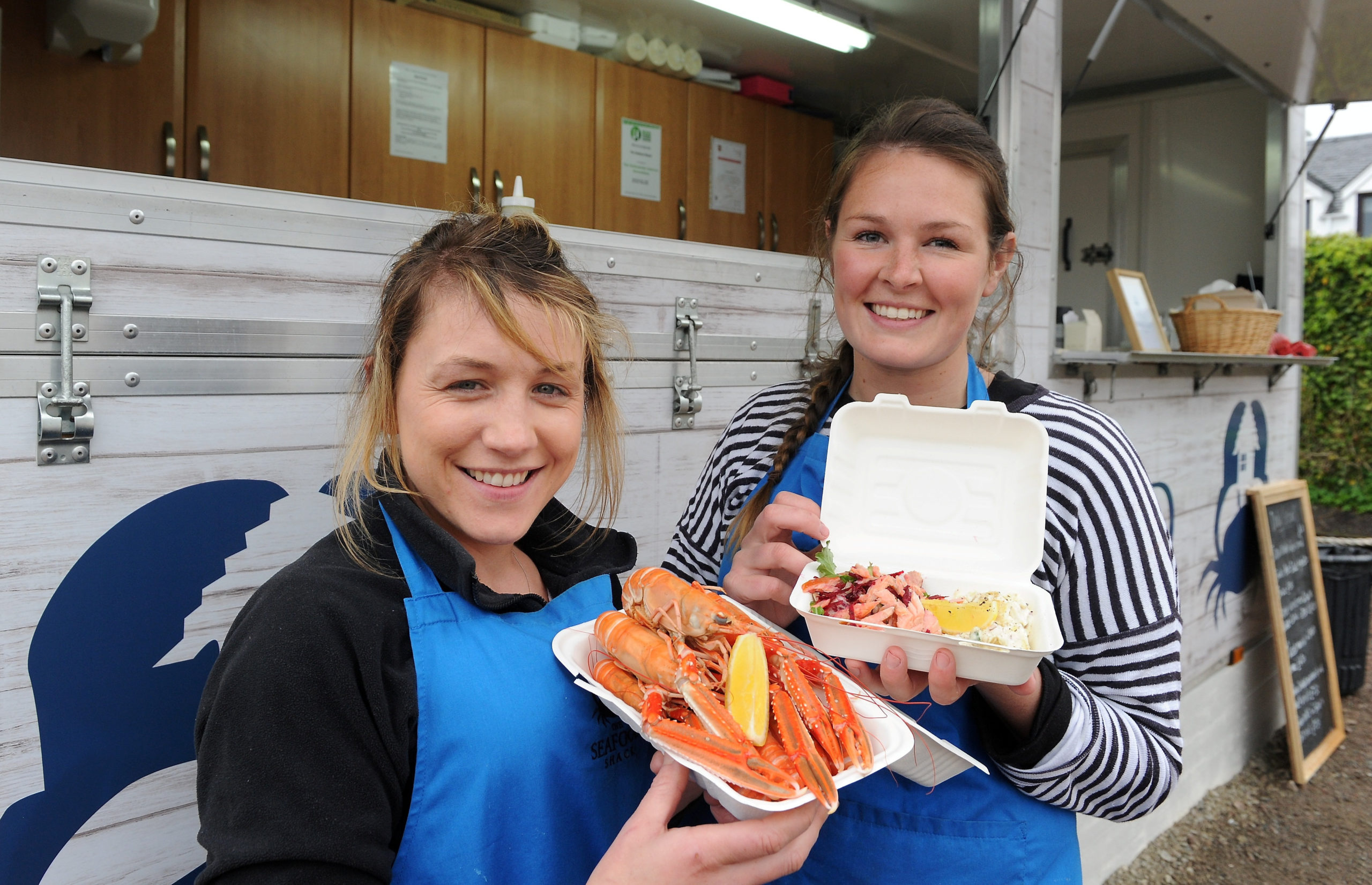 Fenella MacRae (left) and Kirsty Scobie with some of the produce being served at their Seafood Shack