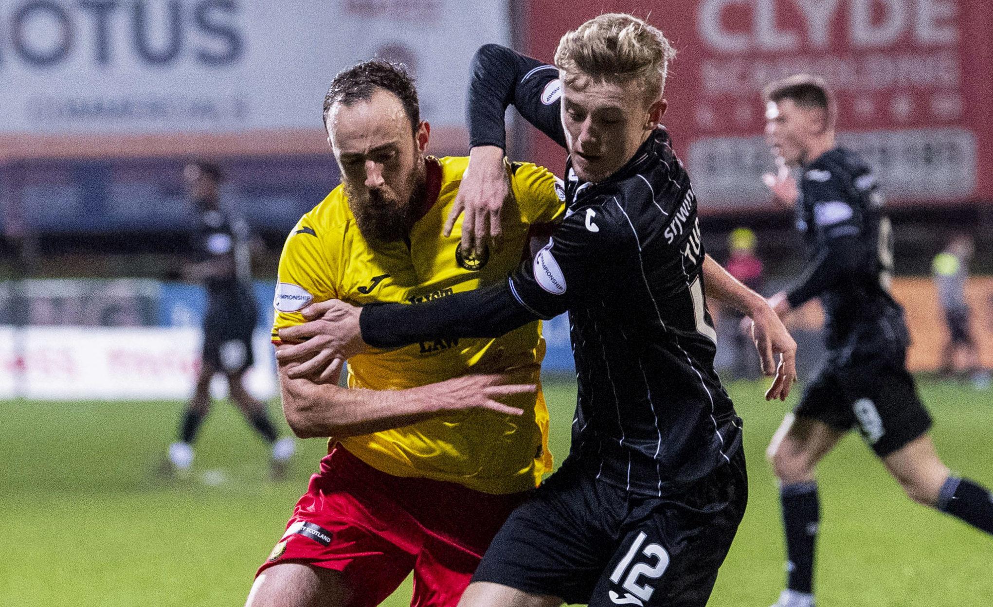 Partick's Stuart Bannigan (left) challenges Dunfermline's Kyle Turner in the last game at Firhill before the coronavirus shutdown