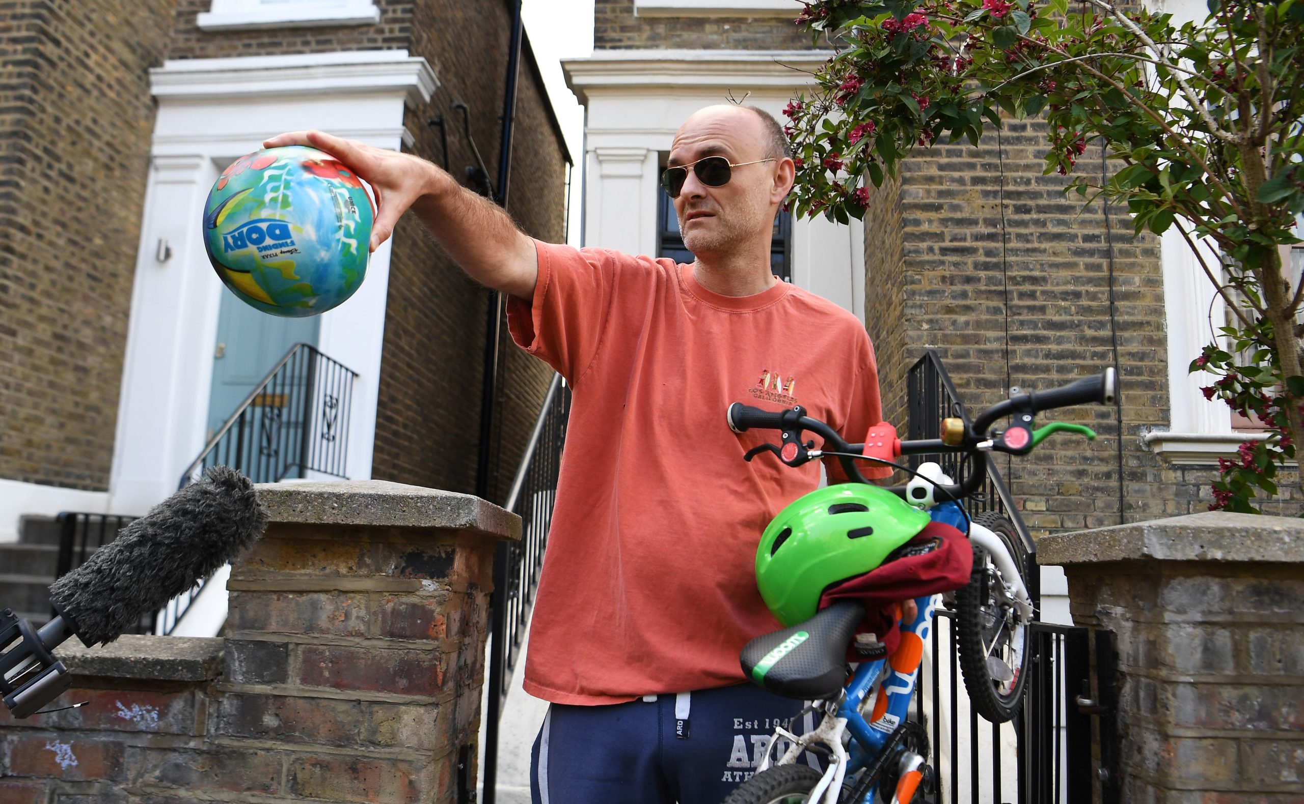 Dominic Cummings tells reporters to socially distance as he emerges from his London home yesterday
