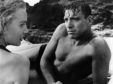 Deborah Kerr and Burt Lancaster in the iconic, sizzling beach scene from Second World War film classic From Here To Eternity