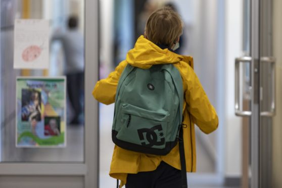 A child returning to school in Poland