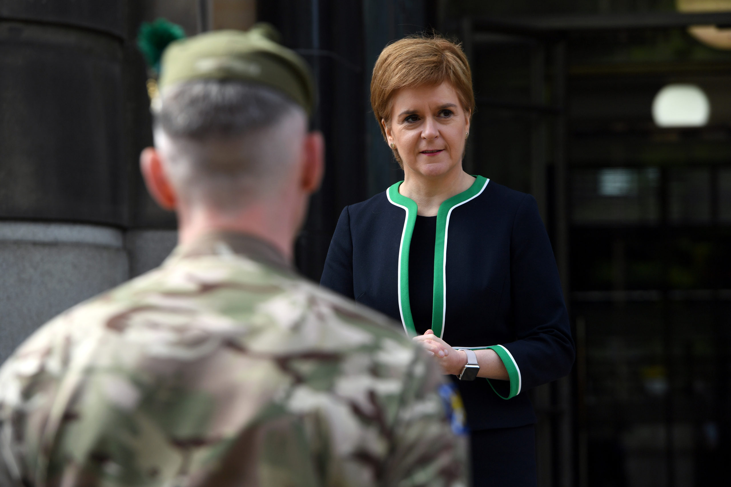 Scotland's First Minister Nicola Sturgeon speaks to members of the armed forces