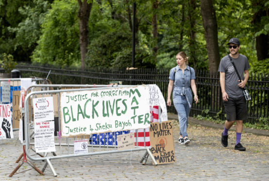 Protest posters outside the US Consulate General office in Edinburgh in response to the police killing of George Floyd in the US