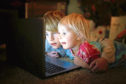 Children can learn when using a laptop, but their screen time should be monitored closely