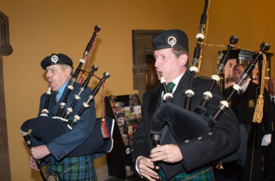 Alastair (right) piping at Glasgow University