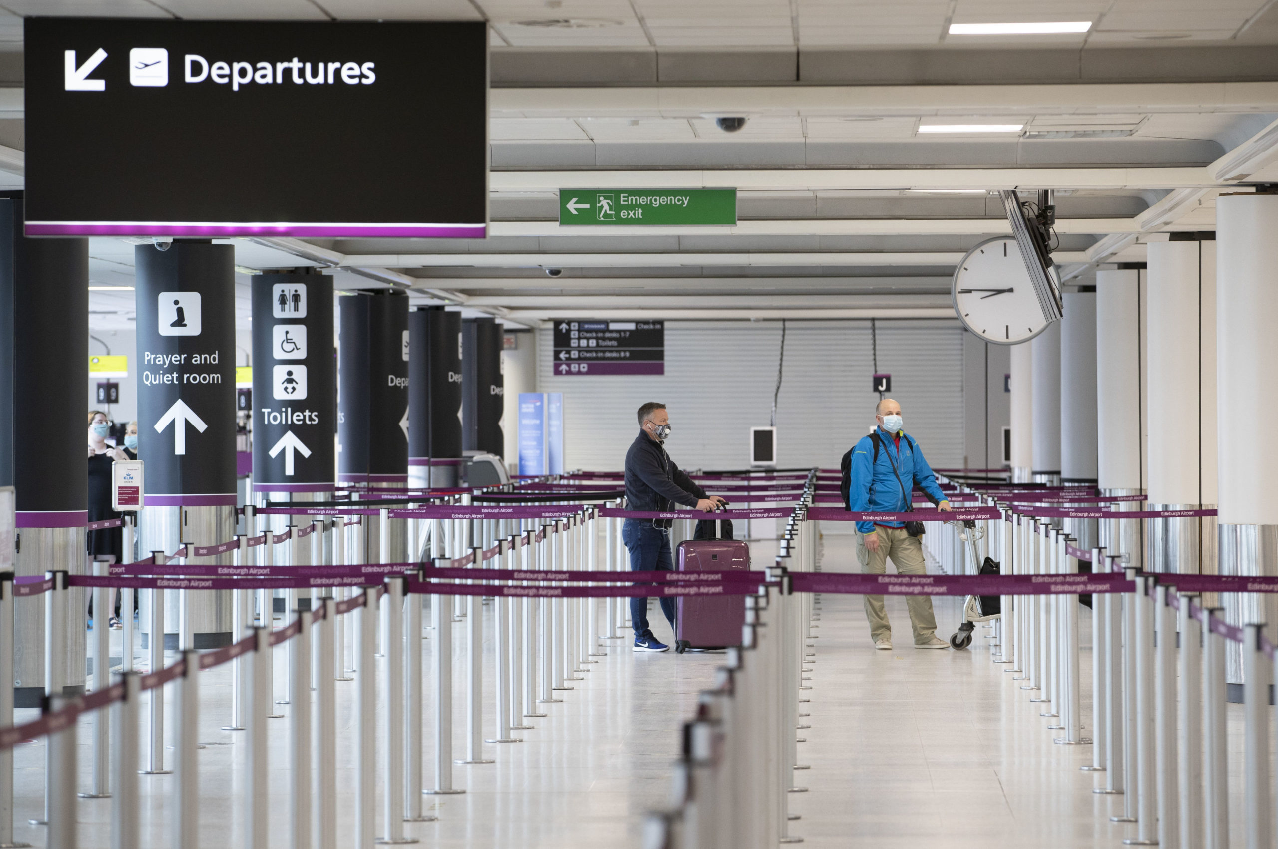 Passengers at the check-in area at Edinburgh Airport