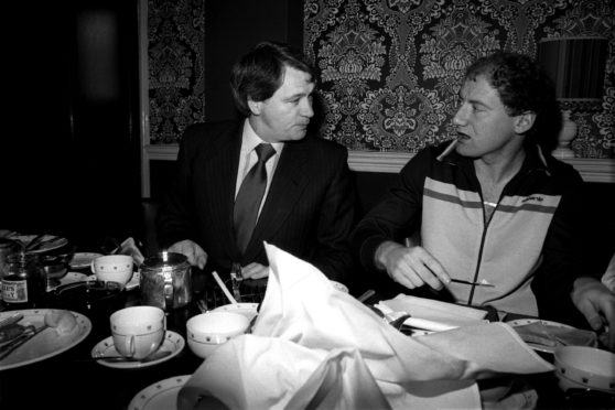 Alan Brazil enjoys a pre-match meal with Ipswich Town manager, Bobby Robson, back in February, 1982