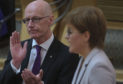 Nicola Sturgeon and John Swinney during First Minister's Questions last week