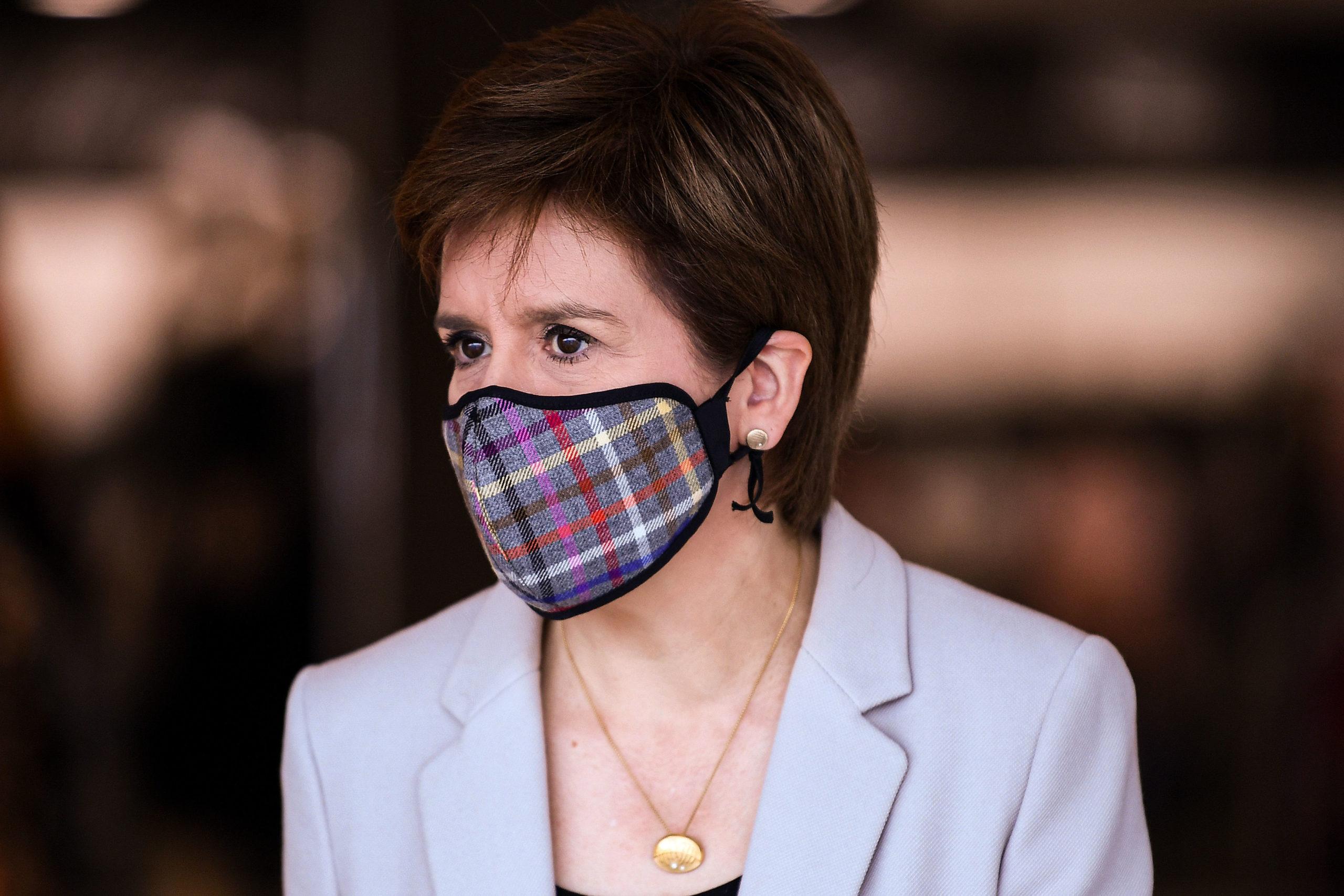 First Minister Nicola Sturgeon wearing a tartan face mask