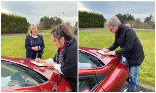 Wedding bonnet: First, Joanna makes it official on mum's car...  Then husband Steve signs the wedding documents in most unusual circumstances