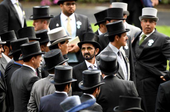 Sheikh Mohammed, centre at Royal Ascot last June