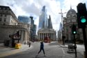 Woman walks in front of Bank of England in London during lockdown