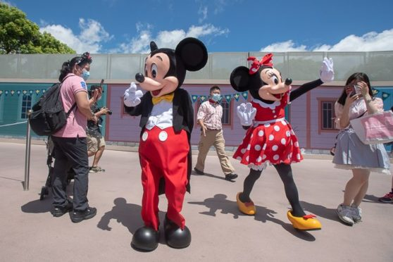 Mickey and Minnie greet visitors as Hong Kong Disneyland reopens