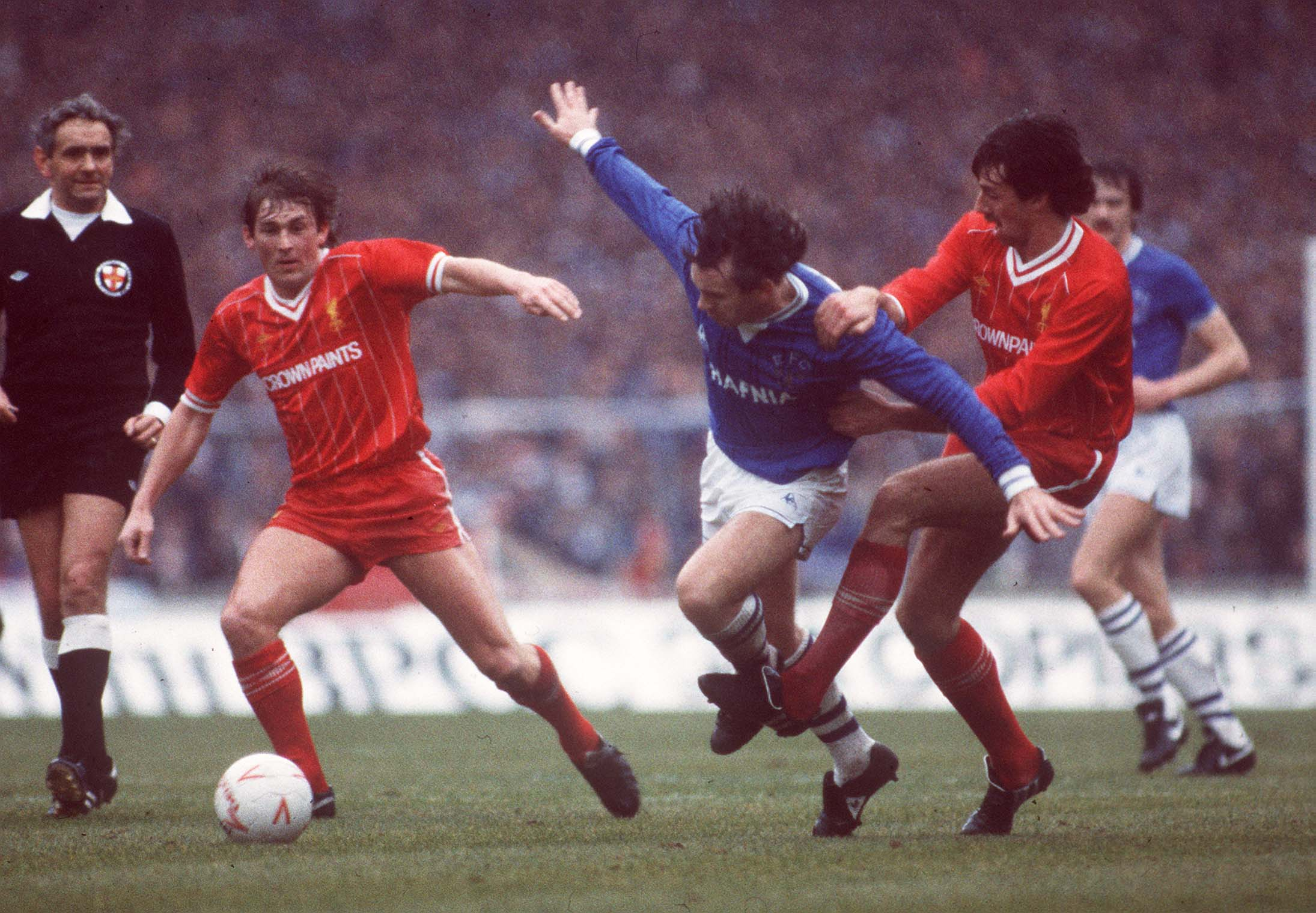 Peter Reid of Everton takes on Kenny Dalglish and Mark Lawrenson in a cup final at Wembley, 1984
