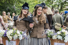 Cyclists in classic clothing celebrate after the 2017 Tweed Run bike ride in London