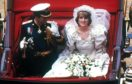 Princess Diana and Prince Charles wave to the crowds on their big day in 1981