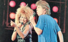 Tina Turner and Mick Jagger perform during Live Aid in Philadelphia July 13, 1985