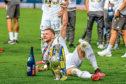 Liam Cooper celebrates Leeds United's title success
