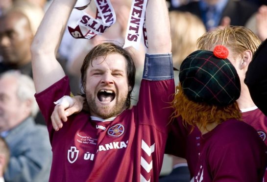 Steven Pressley lifts the Scottish Cup for Hearts in 2006