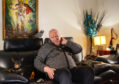 Jim Hendry relaxes at home in Glasgow after the lung cancer trial saved his life