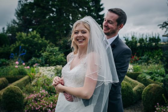 Helena Leslie and John Scott get happily married at Highfield House, Kirknewton, after travelling 340 miles from their home in Northampton for crucial ceremony