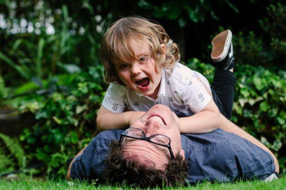 Journalist Martin Watt and son Ollie, two