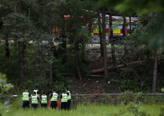Police officers at the scene of crash tragedy near the M9 at Stirling on July 9, 2015, four days after the accident was first reported